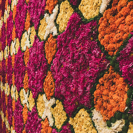 Vibrant floral decor for Mehndi by Amaahyaaj