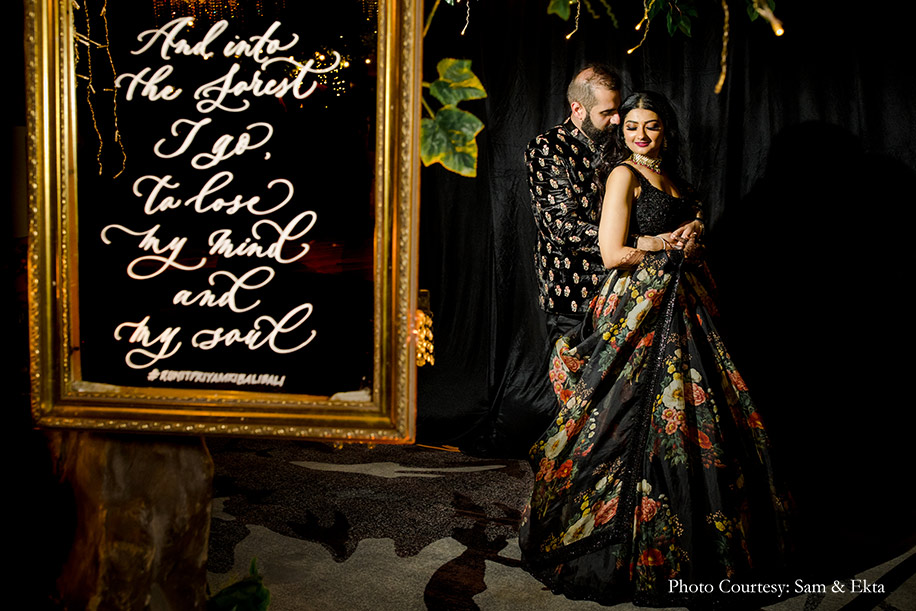 Couple in black sabyasachi oufits for sangeet
