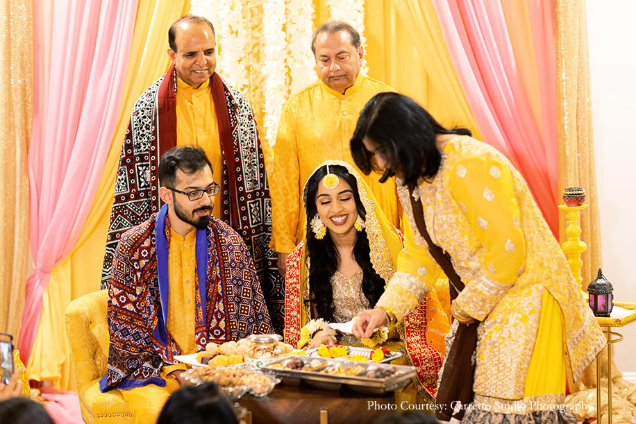 Haldi celebration in yellow outfits